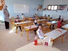 clase primaria marruecos con alumnos y medidas anticovid